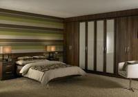 Bedroom furniture range appeals to lovers of darker woods for Fitted bedroom furniture 0 finance
