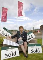 It's a sign of the times as Barratt West sales executive, Myra Stevenson checks out the number of homes sold from plan at the Laurels in Rutherglen.