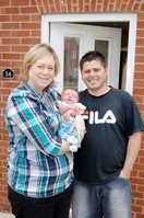 Rachel Walsh and her fiancé Mark with their new baby daughter Holly.
