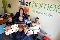 Sales adviser Brenda Frayne with Hilton Primary School students