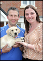 Jo and Mark with their Labrador puppy Biscuit at their home in Fellview, Consett.
