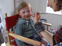 Girl having face painted at Glasdir