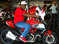 Boxing legend Evander Holyfield visits Ducati Manchester