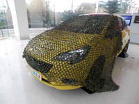 Vauxhall launch camouflage net for the Corsa: 'D is for disappear'