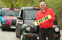 Coventry cabbie playfully holds CAB 131E